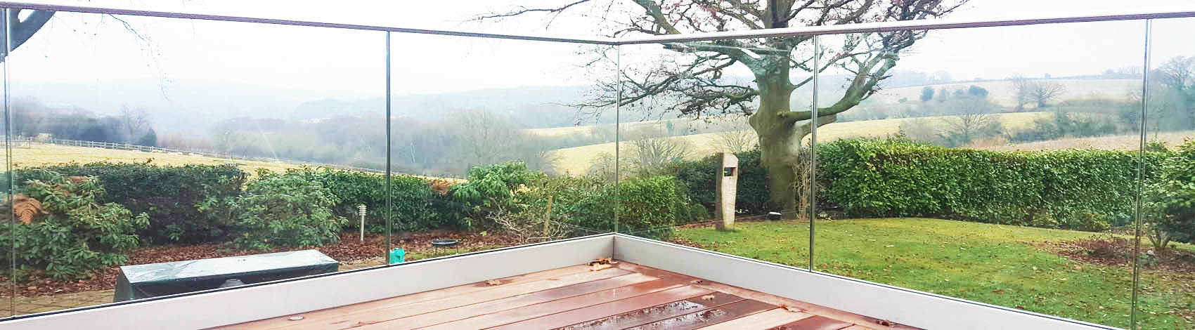 Frameless glass balustrade on timber decking